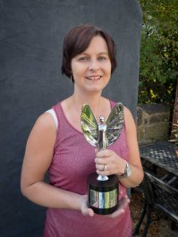 "Paula with her ""Fundraiser of the Year"" award."